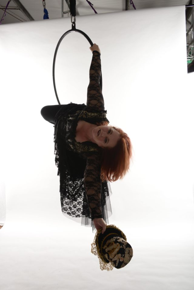 Anita at her first photo shoot wearing a steam punk outfit. pose is under the hoop